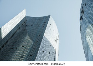 Abstract modern architecture background photo, tall office towers made of glass and steel under blue sky
