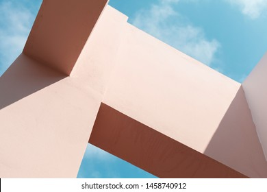 Abstract modern architecture fragment, background photo of a pink facade structures under blue sky at sunny day