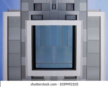 Abstract modern architecture. Windows, grid structures / blinds / louvers and glass wall panels reflecting bright blue sky. Digitally composed photo of office building exterior fragments.