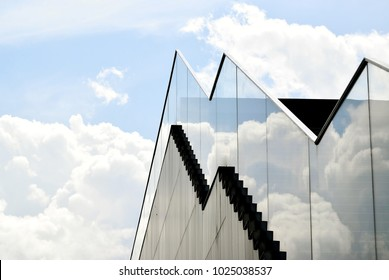 Abstract of modern exterior staircase with glass balustrade against the sky with space for copy