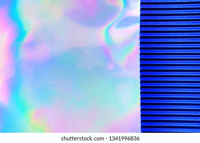 Abstract Modern holographic background with blue metallized corrugated paper. Synthwave. Vaporwave style. Retrowave, retro futurism, webpunk