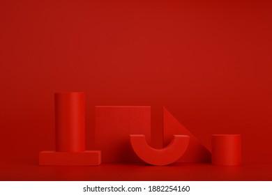 Abstract monochromatic still life in red colors with different geometric figures on red background with space for text