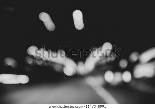 Abstract monochrome background, blur, motion and lights, night highway and nightlife