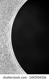 Abstract monochrome detail shot of a modern design cat cave. Half a circle with black space for text on the right.