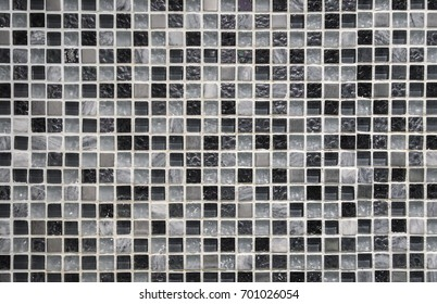 abstract mosaic tile texture with small glassy black, grey and white pieces