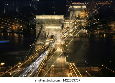 Abstract motion blur in the night city Chain Bridge in Budapest
