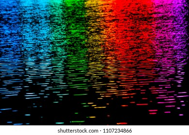 Abstract Motion blurred colorful background Multi-colored bar of lighting to water surface in dark night Soft focus background.