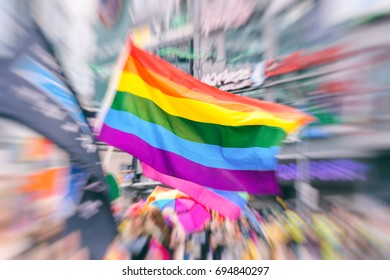 Abstract motion blurred picture of a gay rainbow flag during a pride parade. Concept of LGBT rights.