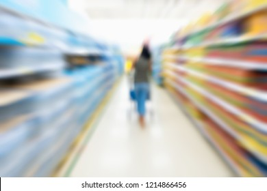 Abstract motion blurred of woman customer is shopping in supermarket store.
