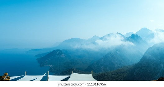 Abstract mountain background with copy space- concept of tourism and travel. Layers of ridges in Tunektepe Teleferik near Anntalia at sanrise sky
