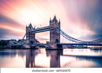 abstract moving clouds during sunrise London Tower Bridge, Sunrise with reflection in the water Thames river London Tower Bridge