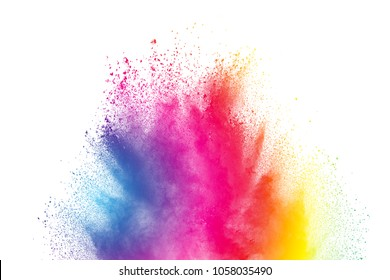 Abstract multi color powder explosion on white background.  Freeze motion of color dust  particles splash. Painted Holi