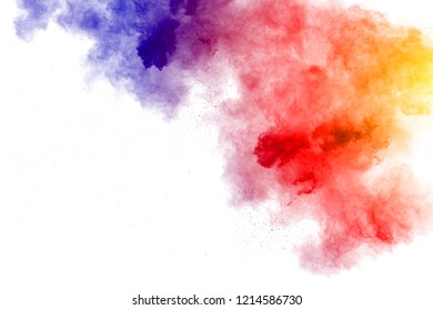 Abstract multi color powder explosion on white background.  Freeze motion of  dust  particles splashing. Painted Holi in festival.