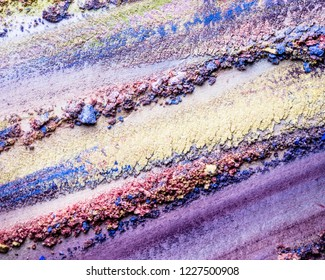 Abstract multicolored background of mixed eyeshadows.