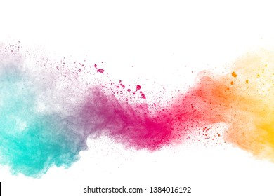 Abstract multicolored powder explosion on white background.Colorful dust explode. Painted Holi powder festival.