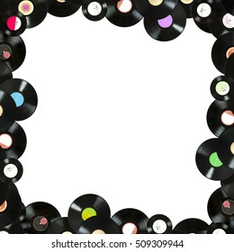 Abstract music colorful frame made of vintage vinyl records, isolated over white background, all labels designed by myself