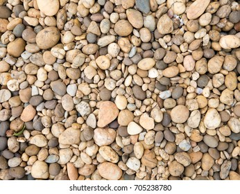 Abstract natural stone background. Nature gravel texture. Pile of pebble pattern. Rock in garden.