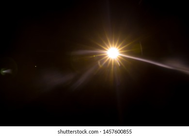 Abstract Natural Sun flare on the black