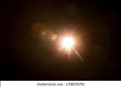 Abstract Natural Sun flare on the black - Shutterstock ID 1708378792