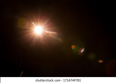Abstract Natural Sun flare on the black - Shutterstock ID 1714749781