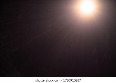 Abstract Natural Sun flare on the black - image