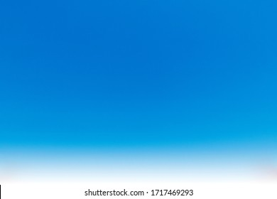 Abstract nature background of beautiful clear blue sky with wispy white clouds in summer sunlight & sun rays for wallpaper & backdrop, gradient seamless pattern & texture details, copy free space
