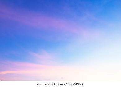 Abstract nature background of romantic pastel sky with silky & wispy cloud in  golden hour time at spring evening. Beautiful puffy & fluffy clouds in bright blue sky in morning sunlight, copy space