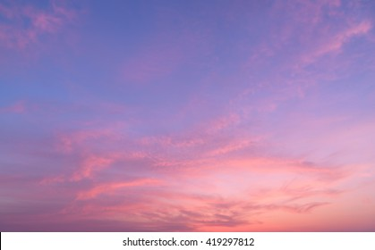 Abstract nature background.Moody pink, purple clouds sun set sky with long shutter