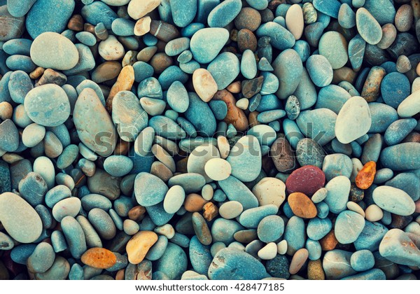 Abstract nature pebbles background. Blue pebbles texture. Stone background.  Blue vintage color. Sea peblles beach. Beautiful nature. Turquoise color