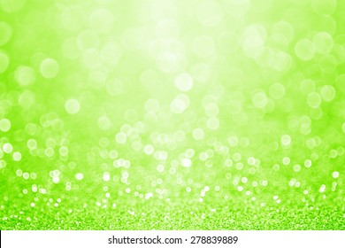 Abstract neon and lime green glitter sparkle confetti background or party invitation for fun happy birthday card, St Patrick's Day poster, wedding design or Christmas texture