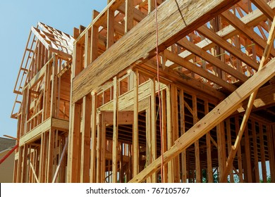 Abstract of New Home Construction Site Framing. New construction home framing