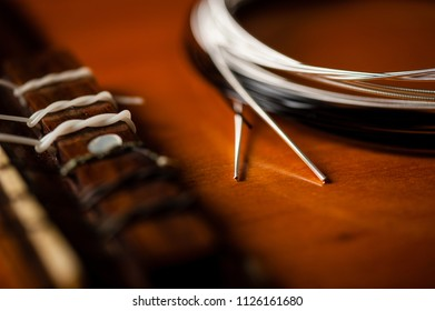 abstract new nylon core guitar strings. Restring classical guitar string concept.