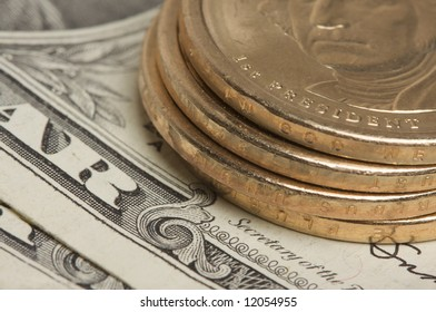 Abstract of the new U.S. Dollar coin on Dollar Bills with Narrow Depth of Field.