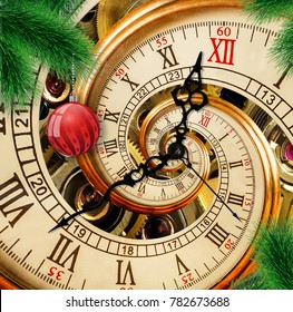 Abstract New Year clock with red ornament ball on green Christmas tree background. Its Christmas time. Happy New Year 2018 card postcard Merry Christmas antique old clock abstract fractal spiral swirl
