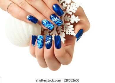 Abstract New Year design on women's nails. Isolated.