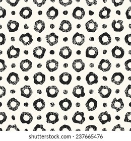Abstract noisy textured dot and ring leopard background. Seamless pattern.