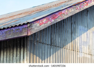 Abstract old building roof and wall with peeling paint and rust