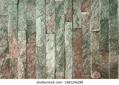 abstract old red natural quartzite stone bricks texture for any purposes.