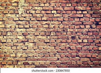 Abstract Old Vintage Cracked Bumpy Rough Brick Wall Textured Grunge Isolated Background in Instagram Art Style.