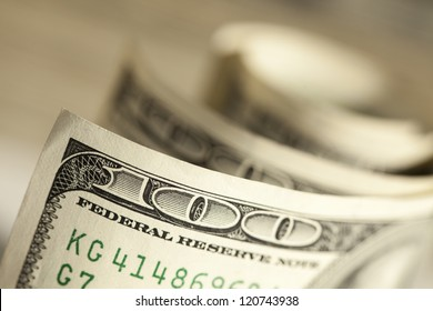 An Abstract of One Hundred Dollar Bills with Narrow Depth of Field.