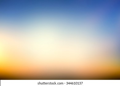 Abstract orange and blue blur color gradient background