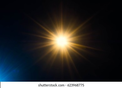 Abstract orange and blue sparkling light rays and lighting flare bokeh against on dark and black sky background