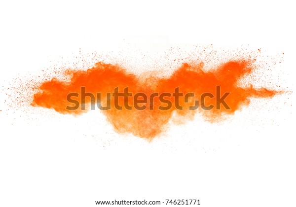 Abstract orange powder splatted background. Colorful powder explosion on white background. Colored cloud. Colorful dust explode. Paint Holi.
