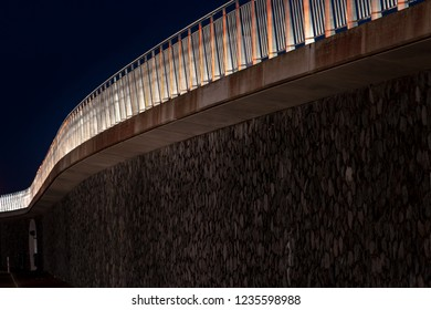 Abstract organic details of a walkway or viaduct in the night.