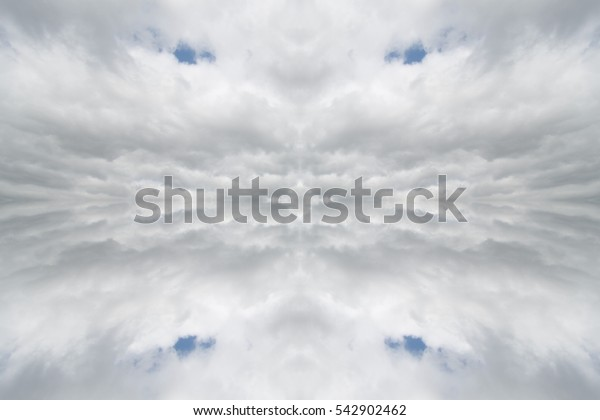 Abstract ornamental cloudy sky, background pattern with fancy kaleidoscope effect texture. Image with symmetry filter, design for fantasy imagination for creative meditation and religious concept