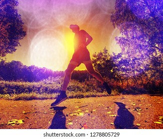 Abstract, over filtered. Man is running marathon on beautiful summer sunset background in rural road