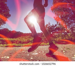 Abstract, over filtered. Man running at the seashore beach, sport lesson. Man silhouette running at sunset with the sun in the background