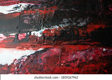abstract paint background. white,black, and red acrylic paint on canvas. textured abstract multi-color background-close-up