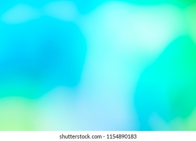 Abstract pale watercolour turquoise bluish yellow green background. Looking upwards to the skies. Happy summer feeling muted pastel wallpaper.