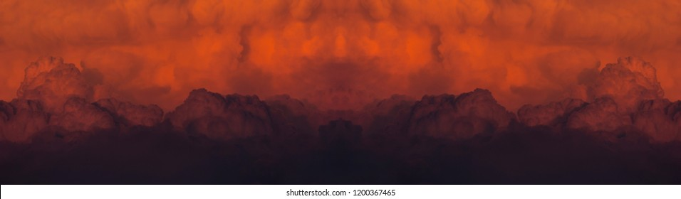 Abstract panoramic of a red cloudy sunset after a huge forest fire.
